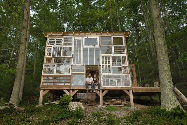 house of windows forest cabin in woods